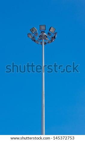 Light pole on sky background