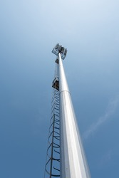 light pole tower in sport arena on blue sky