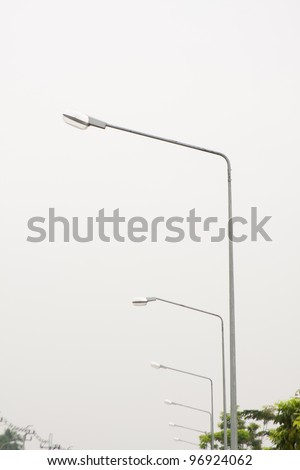 Light poles at the roadside. Lined the streets.