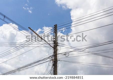 Light poles, power lines and blue sky.