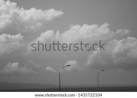 Light post under the sketchy sky  #1435722104