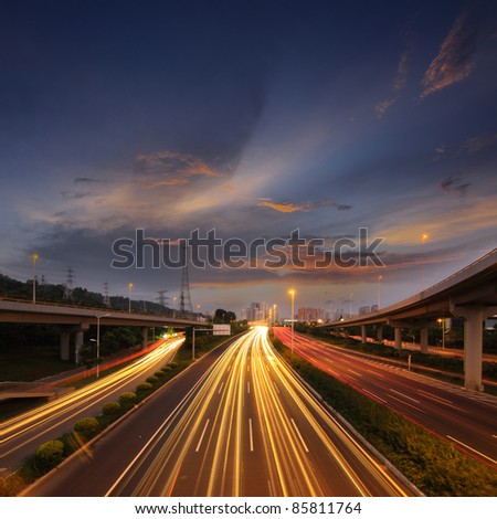 Light rail on the overpass at night