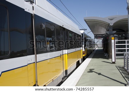 light rail train departing station