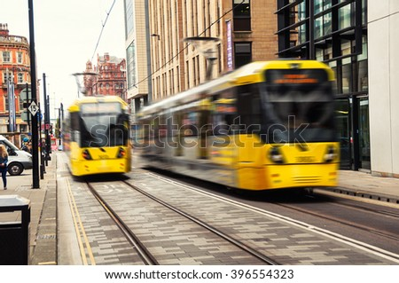 Light rail tram in the city center of Manchester, UK. The system runs through seven of the ten boroughs
