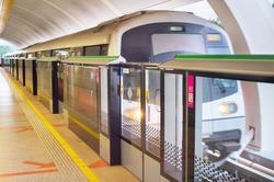 Light rail transit train arrives at a station in Singapore. Metro train motion blur