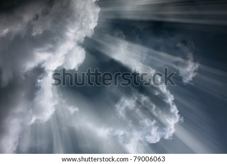 Light rays shine through the dark clouds/Overcast sky before storm