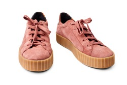 Light red suede sneakers white background isolated close up front view, stylish pink chamois gumshoes, pair of beige leather shoes, two casual boots, fashion slippers, walking footwear, urban footgear