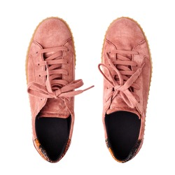 Light red suede sneakers white background isolated close up top view, stylish pink chamois gumshoes, pair of beige leather shoes, two casual boots, fashion slippers, walking footwear, urban footgear