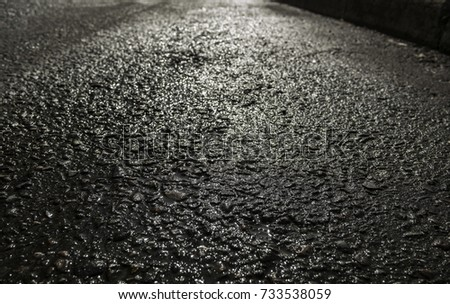 Light reflection on wet asphalt. Wet asphalt. #733538059