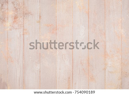 Light rose beige pastel wood background texture with splashes of rose gold #754090189