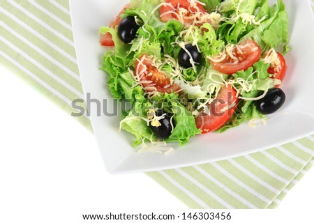 Light salad on plate on napkin  isolated on white
