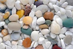 Light sea multi-colored stones close up. Background image, close-up.