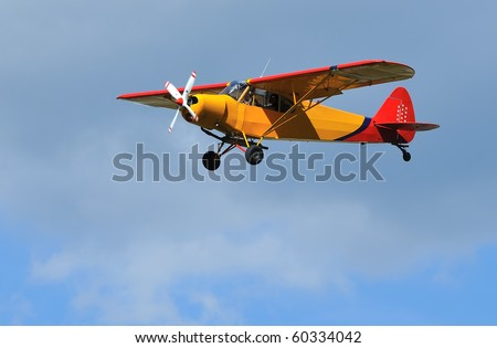light 2-seater aircraft coming in to land. Piper Super Cub, ideal for short take off and landing STOL