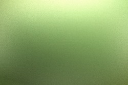 Light shining on rough light green steel plate texture, abstract background