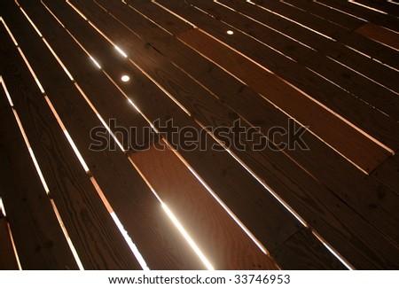 light shining through wooden floor boards