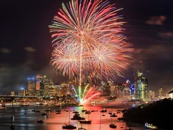 Light show New Year fireworks in City of Sydney - midnight dark sky over skyline.