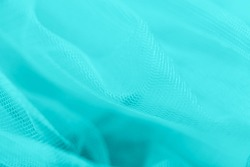 Light small mesh fabric on aqua aquamarine, abstract background