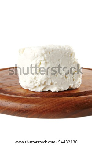 light soft cheese on plate over white