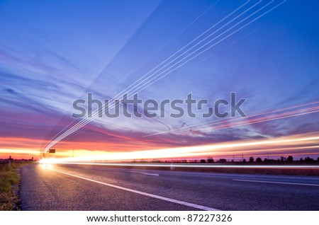 light streaks from long exposure of traffic at sunset