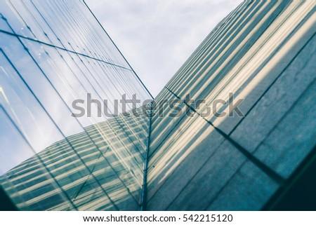 Light streaks hitting the corner of a building #542215120