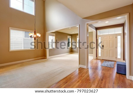 Photo of Light taupe interior with amazing floorplan. Photo of 2 story formal dining room with adjoining formal living room. Northwest, USA