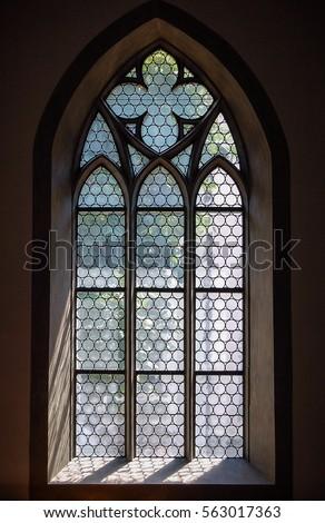 Light through a Gothic stone church window in Schaffhausen, Switzerland