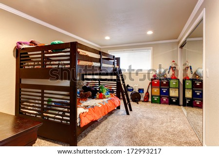 Light tones young adult room with dark brown wooden two level bed and beige soft carpet