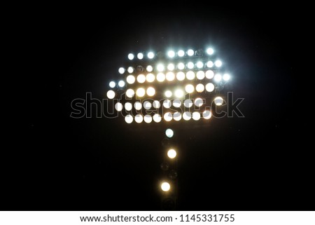 Light tower reflectors at a stadium during nightime. - Shutterstock ID 1145331755