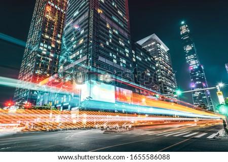 Light trace of modern architecture background in Shenzhen Financ Foto d'archivio ©