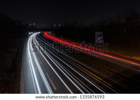 Light tracks of cars on a motorway, Germany #1335876593