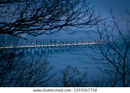 Light trail across the Susquehanna River Bridge in the evening hours on a misty and foggy day, Columbia County, PA