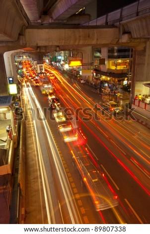 Light trail at a busi Bangkok street
