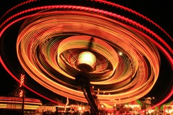 Light trail from a carnival ride at night.