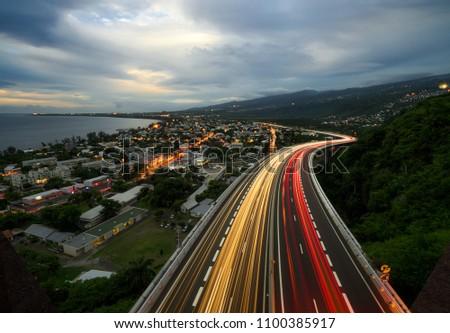 Light trail of cars on the tamarin road in Saint Paul, Reunion Island #1100385917