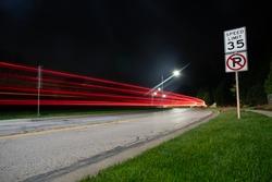 light trail streaking behind a car