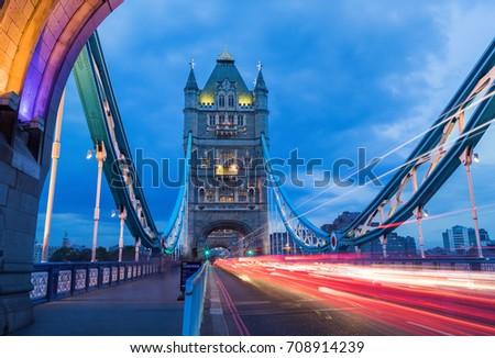 Light trails along Tower Bridge during blue hour, London