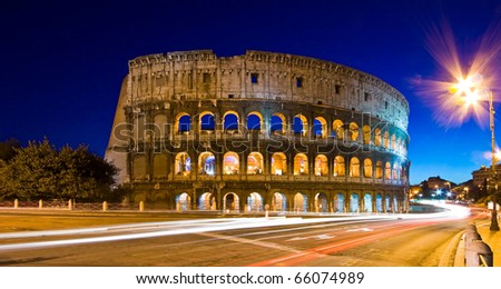 Light trails at Colosseum in twilight, Rome Italy - stock photo