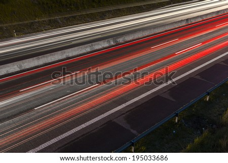 Light trails at night on a highway light bands freeway