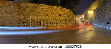 Light trails from  vehicles passing through narrow corridors in the Old City of Jerusalem, Israel.