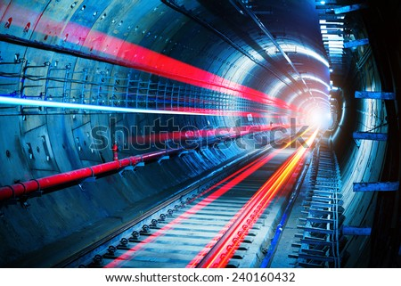 Light trails in the subway tunnel stock photo