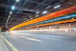 light trails of vehicles in the tunnel   ,futuristic city road background