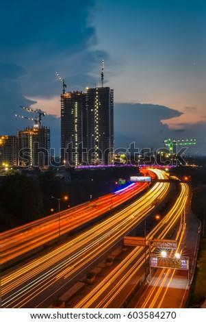 Light trails on Jakarta highway during sunset