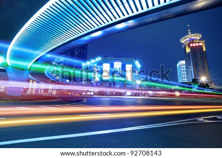 light trails on the center of downtown shanghai at night,China