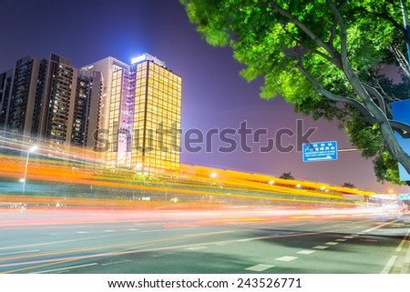 light trails on the city road in guangzhou central business district with modern buildings at night