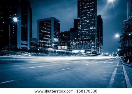 light trails on the modern city street at night