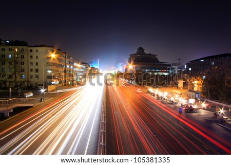 light trails on the modern street at night in beijing financial center, China