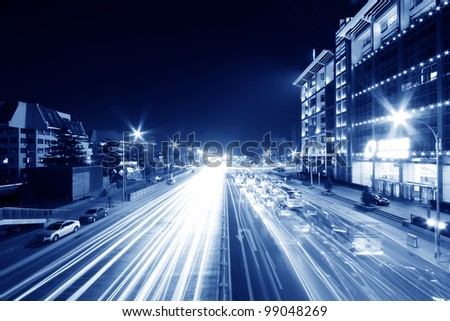 light trails on the modern street at night in beijing financial center,China.