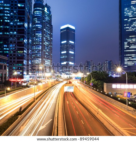 light trails on the modern street at night in shanghai lujiazui financial center,China.