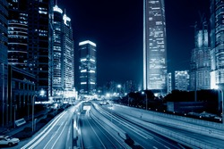 light trails on the street with modern building background in shanghai,China