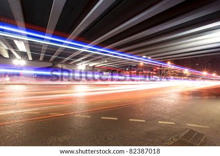 light trails under the viaduct at night in beijing,China #82387018